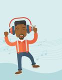 Happy young man dancing while listening to music Royalty Free Stock Photos