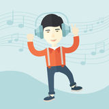 Happy young man dancing while listening to music Stock Photography