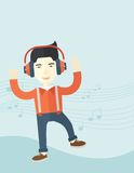 Happy young man dancing while listening to music Royalty Free Stock Photo