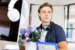 Happy young man designer working. Happy young man designer at his office workplace stock image