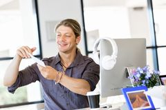 Happy young man designer working. Happy young man designer at his office workplace royalty free stock photo