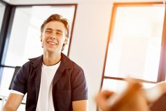 Happy young man designer working. Happy young man designer at his office workplace royalty free stock images