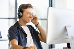 Happy young man designer working. Happy young man designer at his office workplace stock images