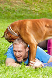 Happy Young Man with Dog Royalty Free Stock Images