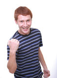 Happy young man doing winning gesture Royalty Free Stock Image
