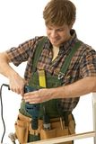 Happy young man drilling Stock Image