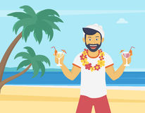 Happy young man enjoying and drinking cocktails on the beach Stock Photo
