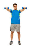 Happy Young Man Exercising With Dumbbells Stock Photo