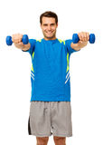 Happy Young Man Exercising With Dumbbells Stock Image