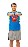 Happy Young Man Exercising With Kettle Bell Stock Photo