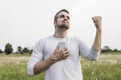 Happy young man in a field Royalty Free Stock Images