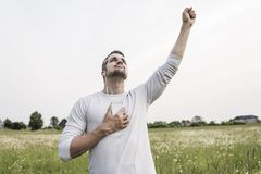 Happy young man in a field Stock Photography