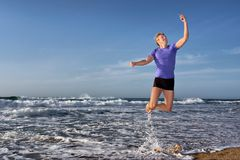 Happy young man flies with mobile phone Royalty Free Stock Photos