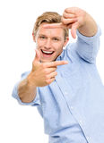 Happy young man framing photograph using fingers isolated on whi Royalty Free Stock Photos