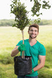 Happy young man gardening for the community Royalty Free Stock Image