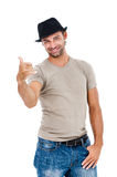 Happy young  man gesturing a call Royalty Free Stock Photo