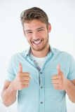 Happy young man gesturing thumbs up Stock Photos