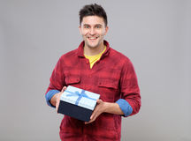Happy young man with a gift Stock Image