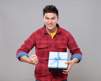 Happy young man with a gift Stock Photo