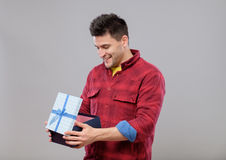 Happy young man with a gift Royalty Free Stock Photo