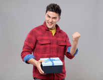 Happy young man with a gift Royalty Free Stock Photography