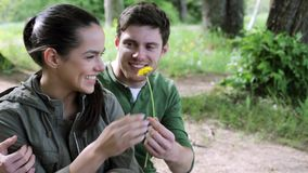 Happy young man giving flower to woman outdoors 12 stock video footage