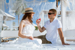 Happy young man giving a red heart to his woman Stock Image