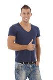 Happy young man giving thumb up. Happy young athletic man giving thumb up, smiling at camera, isolated on white Stock Photo