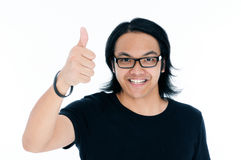Happy young man giving a thumb up sign. Portrait of a happy young man giving a thumb up sign over white background Stock Photos