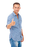 Happy young man giving you the thumbs up Royalty Free Stock Image