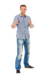 Happy young man giving you the thumbs up Stock Images