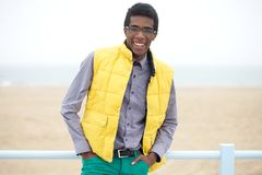 Happy young man with glasses and wearing colorful clothing Stock Photos