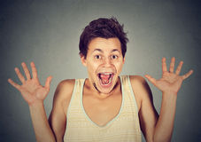 Happy young man going crazy screaming super excited Royalty Free Stock Photography