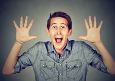Happy young man going crazy screaming super excited surprised Royalty Free Stock Images