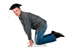 Happy young man in graduation cap Stock Image