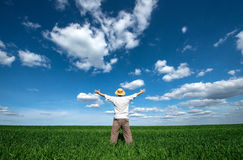 Happy young man on green field of wheat Royalty Free Stock Photography