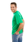 Happy young man in green shirt isolated on white. Stock Photos