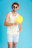 Happy young man in hat and sunglasses holding frisbee disk Royalty Free Stock Photography