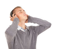 Happy young man with headphones Royalty Free Stock Photo