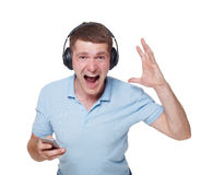 Happy young man with headphones sing and enjoy music Royalty Free Stock Photo