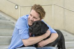 Happy young man with his dog Stock Images