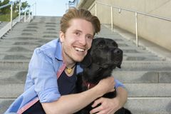 Happy young man with his dog Royalty Free Stock Photos