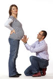 Happy young man and his pregnant wife Royalty Free Stock Image