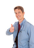 Happy young man with his thump up. Royalty Free Stock Photos