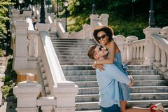 happy young man holding african american girlfriend royalty free stock images