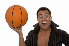 Happy young man holding a basketball. Ball Royalty Free Stock Photo
