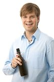 Happy young man holding beer Stock Photos