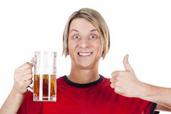 Happy young man holding beer Royalty Free Stock Photo