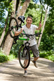 Happy young man holding a  bicycle Stock Image