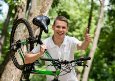 Happy young man holding a  bicycle Stock Photo
